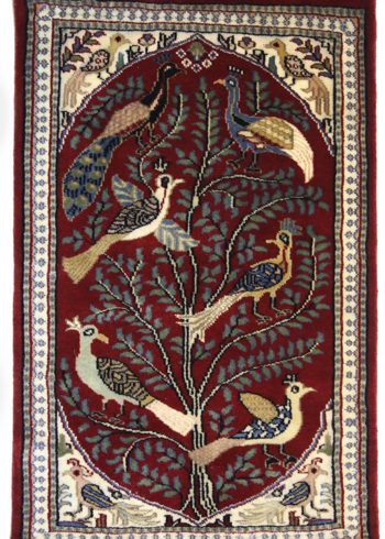 Pictorial carpet with birds and tree design