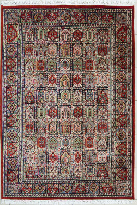 Hand knotted red coffee table rug